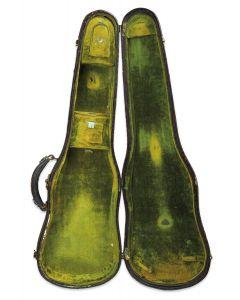 C. 1910, the reptile exterior, the green velvet interior.