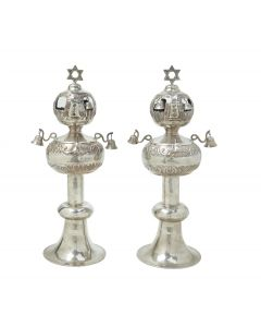 Uniformly set on large round bases with circular midsections. Upper portions bulbous. Fitted with bells, each topped with a Star-of-David. Height: 15.2 inches (36.6 cm).