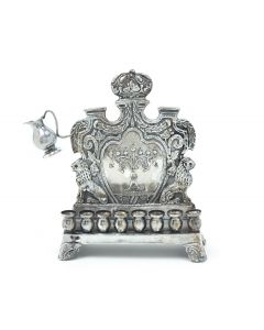 Crafted by M. Charlop. Rectangular base with eight oil holders. Backplate chased in royal design featuring Menorah at center. The whole set on four decorative feet. Signed. 9.5 x 7 inches (24 x 18 cm).